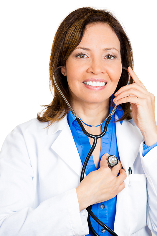 Self-diagnosis. Female cardiologist listening to her heart